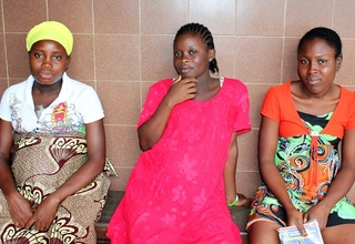 Pregnant teens await ante natal services at a clinic in Monrovia