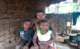 A teenage mother along with her two children in Liberia